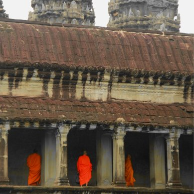 Monks in orange robes in Angkor Wat