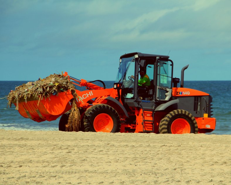 A orange backhoe in Kuta, Bali, Indonesia