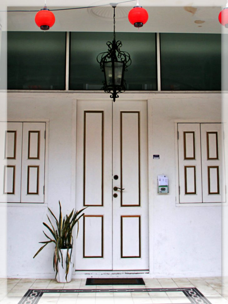 A neat white door in an old house in Malacca