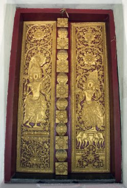 The door with gold painted in a temple in Luang Prabang