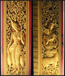 Gold painted carvings on a door in a Temple in Luang Prabang, Laos