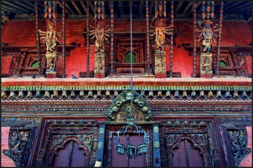 The intricate carvings on roof and door of Changu Narayan