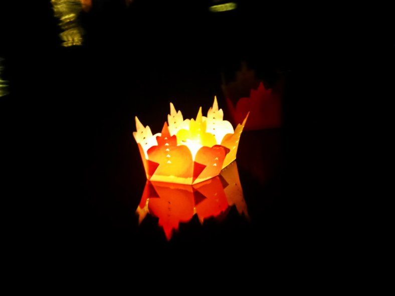 Weightless small crown-shaped containers with a candle inside