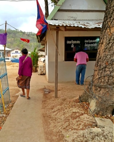 The End of Tunnel - Small Kiosk wih Lao Flag