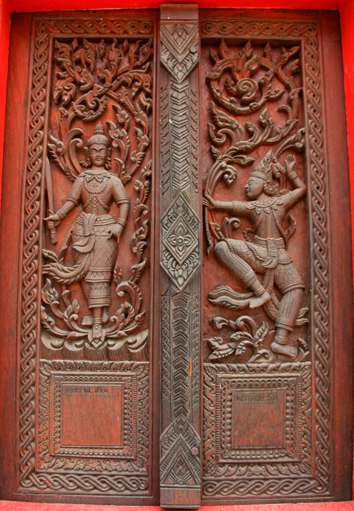 The door's Carvings on Temple in Wat Ban Na Muang, Ubon