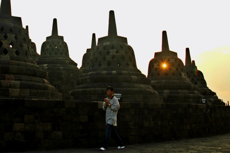 A man does the rite of circumambulating at Borobudur