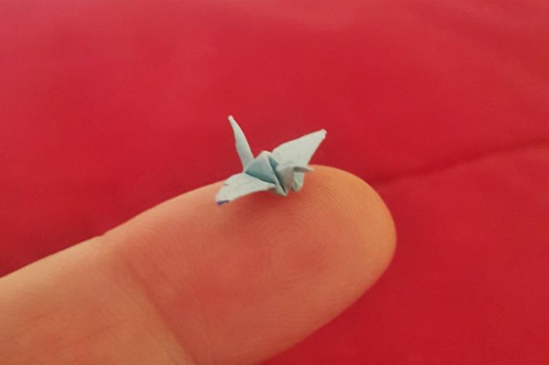 A tiny paper crane origami