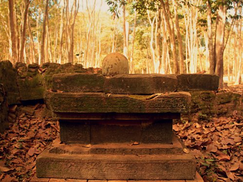 A Linga-yoni in a ruined shrine