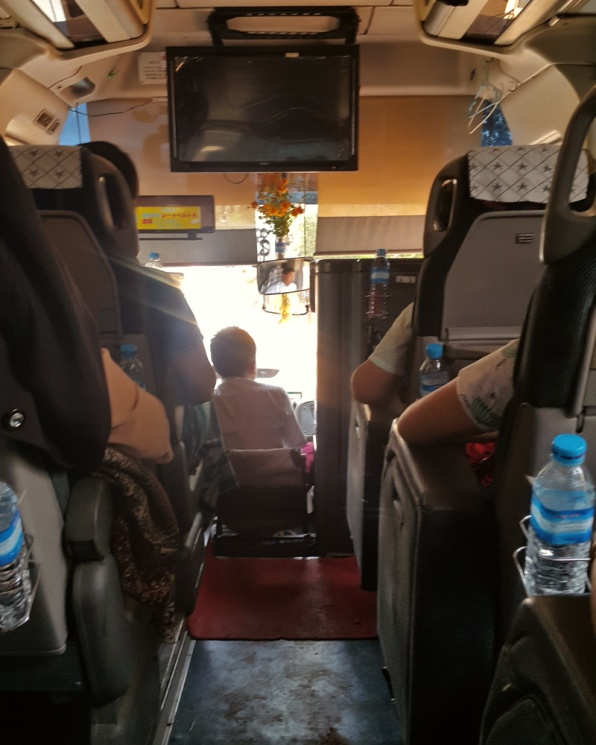 Sitting on the additional seat of a scania bus