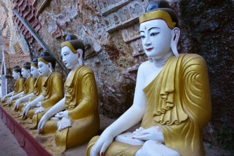 A row of Buddha Images before the entrance